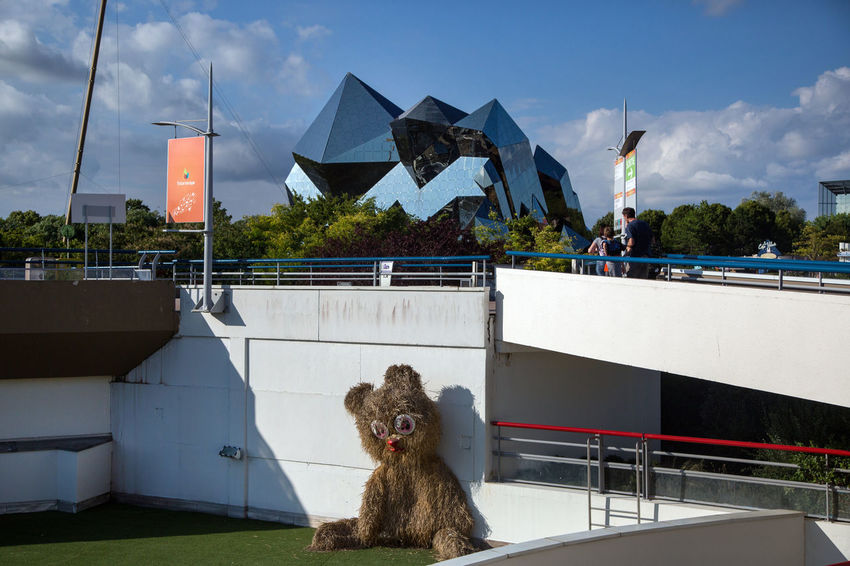 Futuroscope Theme Park Futuroscope Theme Park | Poitiers - France Futuroscope2017 Leisure Park Animal Themes Architecture Building Exterior Built Structure Cloud - Sky Day Dog Domestic Animals Mammal Nature No People One Animal Outdoors Railing Roof Sky Tree