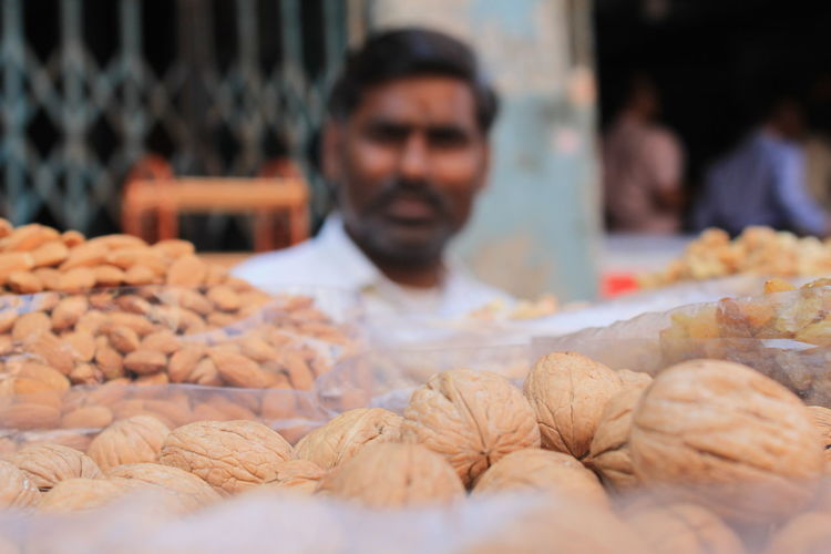 Man selling dried fruits at market stall