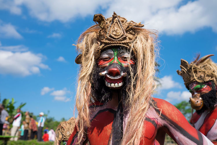 Magelang, Indonesia - June 24, 2016: Jatilan dance before performance at the Five Mountains Festival. The event was held to celebrate local art and culture. Arts Culture And Entertainment Celebration Cloud - Sky Costume Day Disguise Festival Focus On Foreground Headshot Incidental People Leisure Activity Lifestyles Mask One Person Outdoors Portrait Real People Sky Women