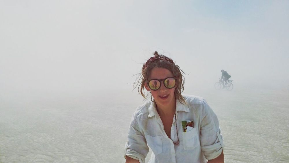 Lost In The Dust Burning Man Nevada Desert Nevada Cycling Bike Sandstorm Portrait Front View Lifestyles Sunglasses Looking At Camera Leisure Activity Standing One Person Long Hair Real People Sky Young Adult Eyeglasses  Day Outdoors Young Women Desert Festival Women Around The World