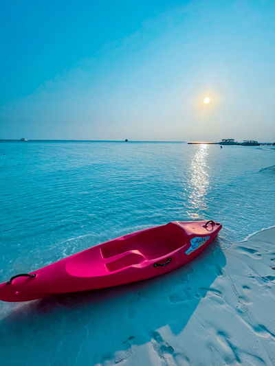 Boat in sea against blue sky