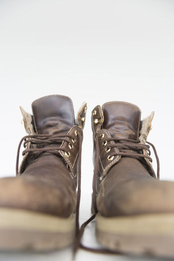 Close-up of boots against white background