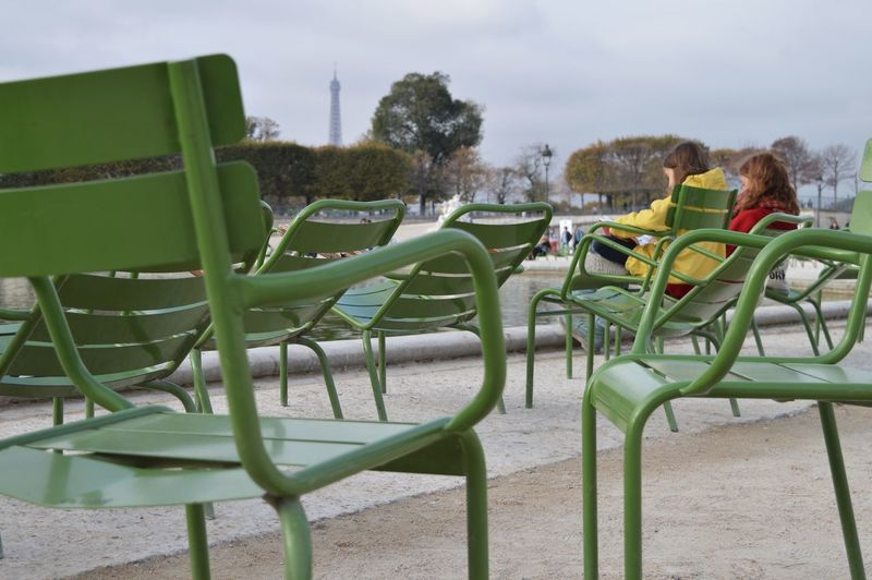 green park chairs of Paris By The Pond Reading A Book Reading & Relaxing Green Chairs Park Chair Pond Paris Eiffel Tower Friendship Child Childhood Sky