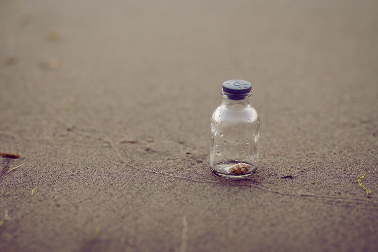 EyeEm Best Shots Beach Botle On Sand Bottle Bottle On Seashore Bottle On The Beach Close-up No People Outdoors Sand Sand And Shell Selective Focus Shell Shell In A Bottle