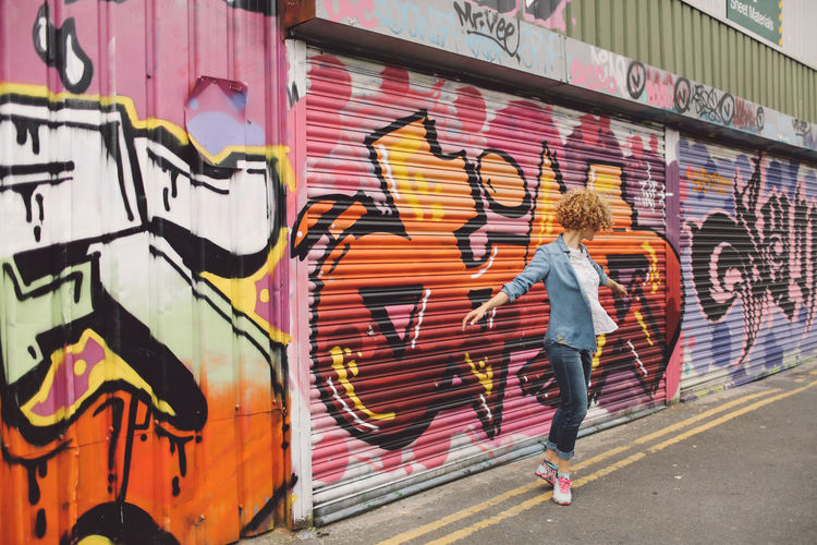 Architecture Art Blonde Brighton Built Structure City Creativity Curly Hair People And Places Girl Graffiti Graffiti Graffiti Art Joyful Jumping Lifestyles Multi Colored Outdoors Painting Playful Spinning Street Street Art Streetart Wall - Building Feature Art Is Everywhere
