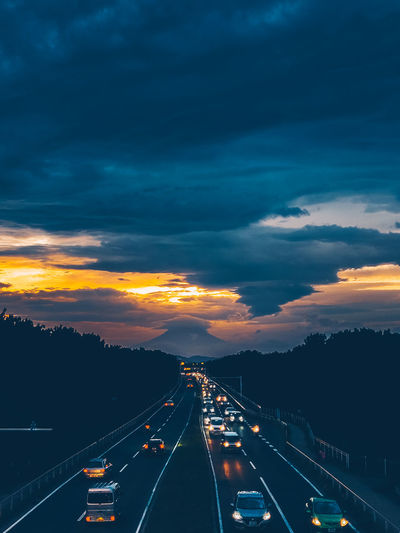 Aerial view of highway at sunset