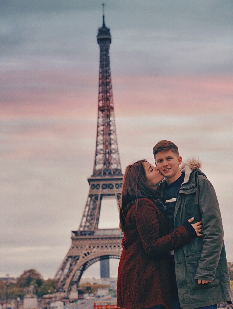 architecture, travel destinations, tower, two people, built structure, travel, young women, women, city, sky, young adult, tourism, lifestyles, young men, love, warm clothing, real people, couple - relationship, tall - high, positive emotion, outdoors