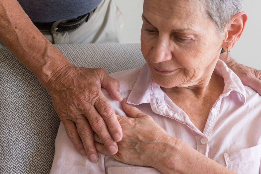 Older woman being comforted Adult Adults Only Affectionate Bonding Care Domestic Life Geriatrics Grandmother Healthcare And Medicine Home Caregiver Human Body Part Human Hand Indoors  Love Men Patient Retirement Senior Adult Senior Couple Senior Men Senior Women Sitting Togetherness Two People Women