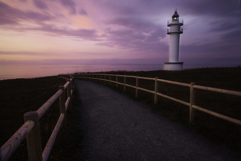 Ajo Lighthouse, follow me on Cantabria SPAIN Ajo Beauty In Nature Cloud - Sky Faro Landscape Lighthouse Nature No People Outdoors Road Sea Seascape Sunset Tranquil Scene Water