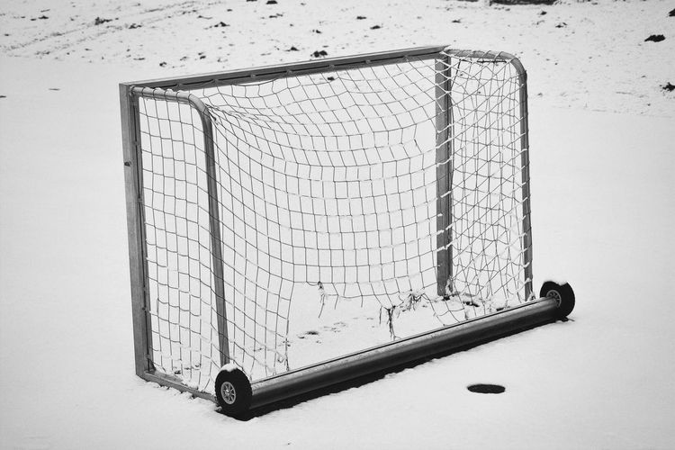 Close-up of soccer goal in snow