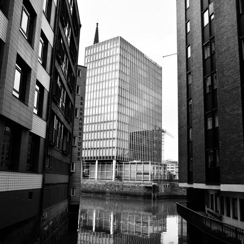 NIKOLAIFLEET. Nikon Photooftheday Photography EyeEmBestPics EyeEm Selects EyeEm Best Edits EyeEm Best Shots EyeEm Gallery Hamburg Close-up Capture Check This Out Blackandwhite Photography Black White Blackandwhite Canal Built Structure Building Exterior Architecture Water City Building Sky Reflection Tall - High No People Travel Destinations Outdoors Skyscraper Capture Tomorrow