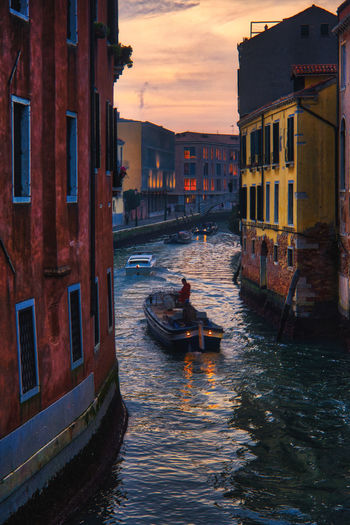 Venetian life Venezia Venice, Italy Architecture Building Exterior Built Structure Canal City Day Gondola Gondola - Traditional Boat Gondolier Men Mode Of Transport Nature Nautical Vessel Outdoors People Real People Sky Sunset Transportation Venice Water Waterfront