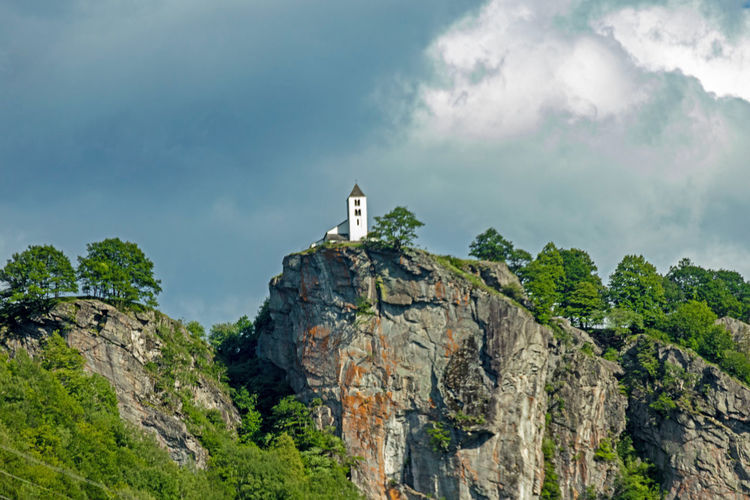 Chapel Church EyeEm Nature Lover EyeEm Gallery Kapelle Kirche Naturfotografie Beauty In Nature Cliff Cloud - Sky Formation Low Angle View Mountain Nature No People Outdoors Plant Rock Rock - Object Rock Formation Scenics - Nature Sky Solid Tree