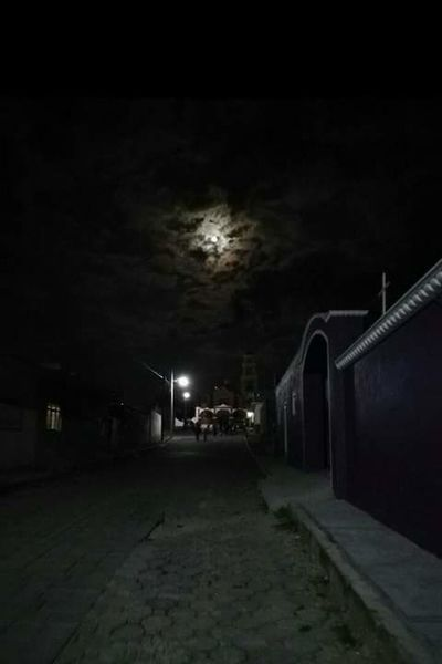 Ante una luz cegadora perdiste de vista la sombra. Sin Filtros Nightphotography City Illuminated Moon Bridge - Man Made Structure Street Light Spooky Ghetto Sky Architecture Building Exterior Storm Cloud Full Moon