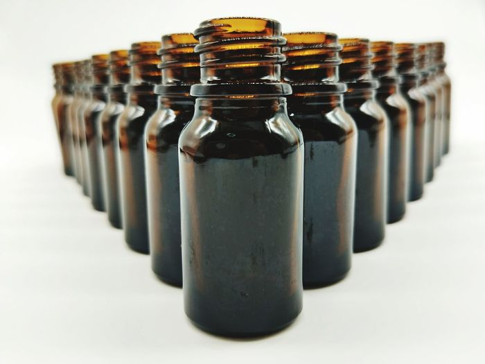 Close-up of bottles against white background