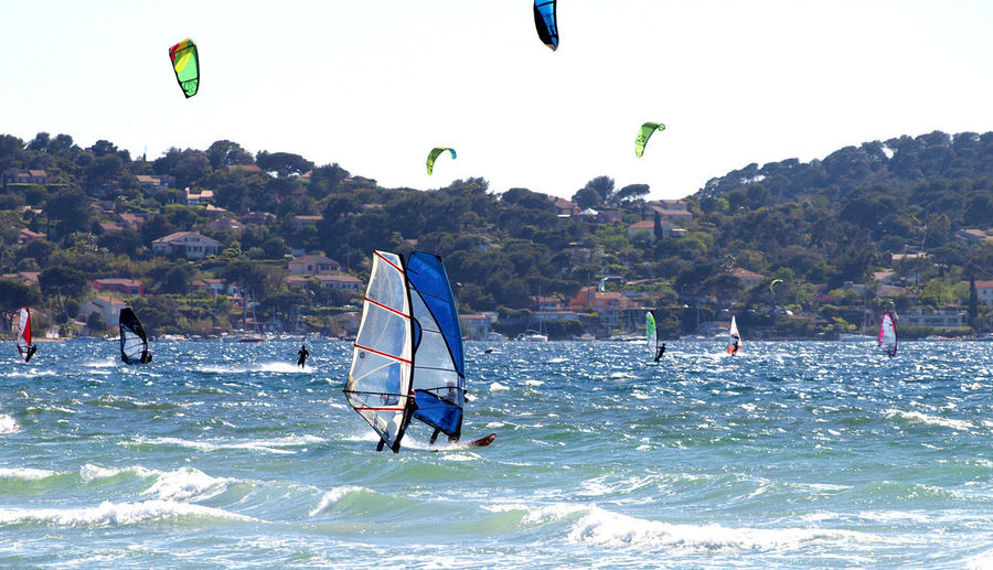 Leisure Activity Extreme Sports Adventure Sport Windsurfing Surfing Hyères Les Palmiers Large Group Of People Le Var People Vacations Water Nature Outdoors Sea Real People Wave Sky Flying Adult Adults Only Day