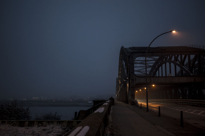 Beauty In Nature Bridge Bridge - Man Made Structure City Connection Foggy Illuminated Misty Evening Nature Night No People Outdoors Scenery Scenics Sky Snow Travel Destinations Winter