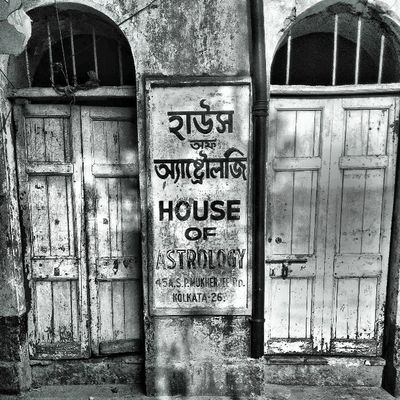 House of Astrology in Calcutta. This is only possible in Calcutta. Kolkata Incrediblecalcutta door bw black white old shops indianigers igersindia ig_india igers india