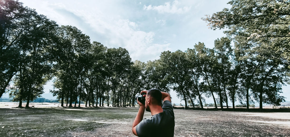 Man photographin the trees