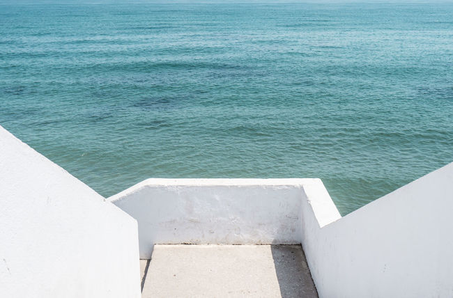 Non stress area Architecture Bluesea Built Structure Calm Calm Water Calming Calmness Day High Angle View Minimal Minimallove Minimalobsession Nature No People Nopeople NOstress Ocean Outdoors Relax Relaxation Sea Sunlight Tranquil Scene Tranquility Water Sommergefühle