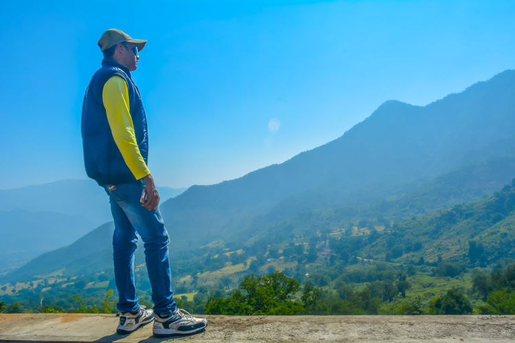 Only Men One Man Only One Person Adults Only One Young Man Only Full Length Landscape Outdoors People Mountain Nature Young Adult Adult Beauty In Nature Men Sky Day The Great Outdoors - 2017 EyeEm Awards New Collection  Album Cover Wall Paper Freshness Travel Photography Traveler