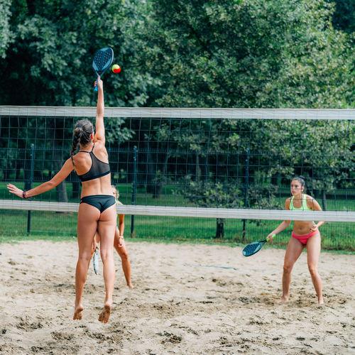 Beach tennis players at the net
