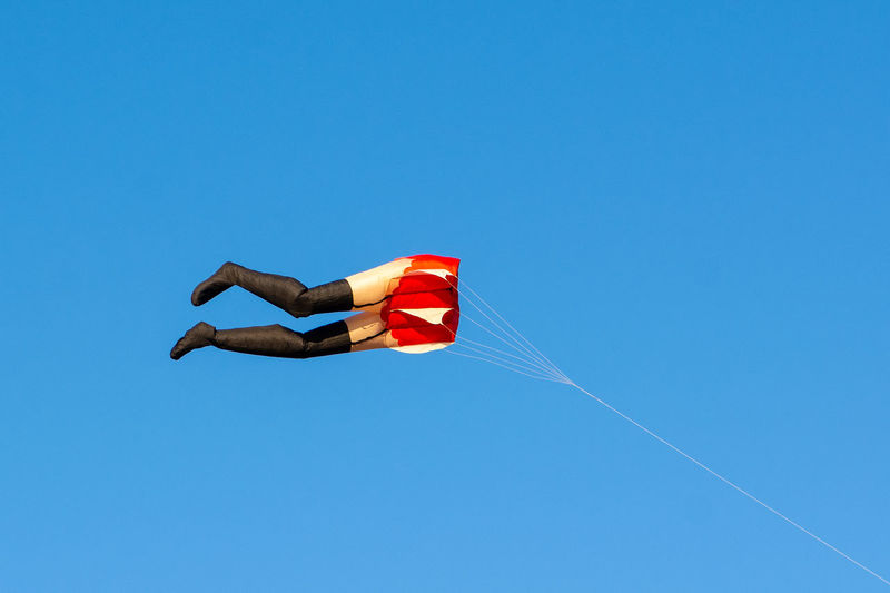 Kite being flown at the Felixstowe beach. What else can I say? Kite Blue Sky Sky Clear Sky Flying Legs Suspenders Kite Flying Kite Flying At The Beach