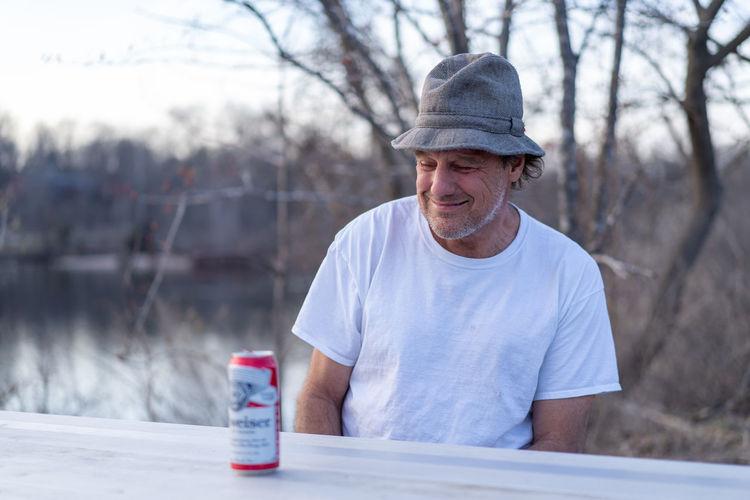 Portrait of man drinking bottle