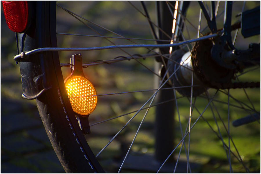 The bright sun is refracted in the cataphor on the wheel of a bicycle. Bright Sun Wheel Of A Bicycle Sun Rise Cataphor Refracted Refracted Light Refractedlight Sun Light Sun Set