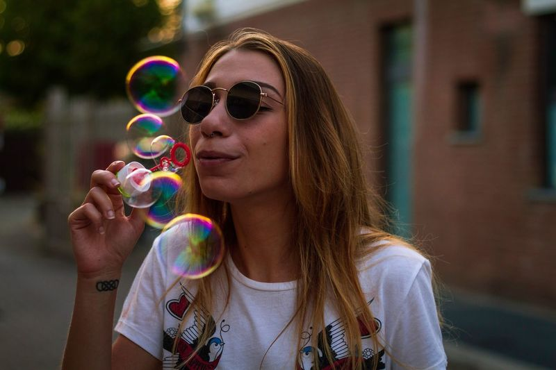 Close-up of young woman in bubbles