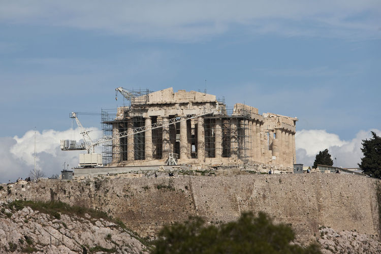 Parthenon with crane and scaffolding against sky