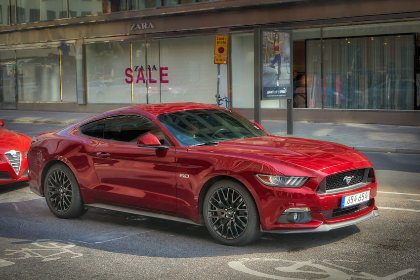 Now that's a nice ride! Mustang Car Motor Vehicle Mode Of Transportation Red Transportation Land Vehicle City Communication Sports Car