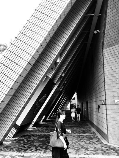 Lady in lines Blackandwhite Femininity Architecture Real People Built Structure Lifestyles Day Leisure Activity Adult Women People Building Exterior Togetherness Connection Walking Outdoors #urbanana: The Urban Playground Urban Fashion Jungle