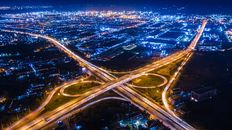 Aerial view interchange ring road and motorway freeway highways and moving headlight cars