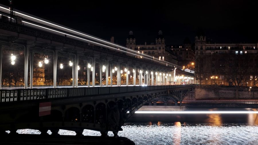 Night Bridge - Man Made Structure Illuminated City Travel Destinations Water Architecture Cityscape Outdoors History River Tree Vacations Connection Sky No People Paris France Pontdebirhakeim