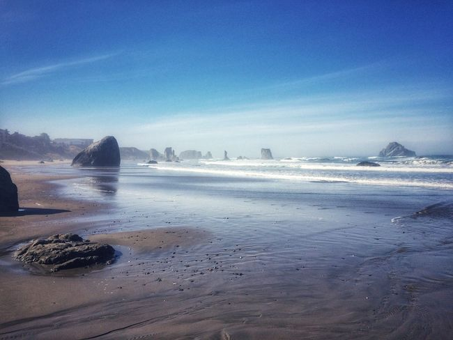 Beach large sea stacks in the distance on the Oregon coast Pacific Northwest Beauty Water Beauty In Nature Nature Scenics Outdoors Tranquil Scene Blue Beach Landscape Travel Destinations Motion Sea No People Sky Tranquility