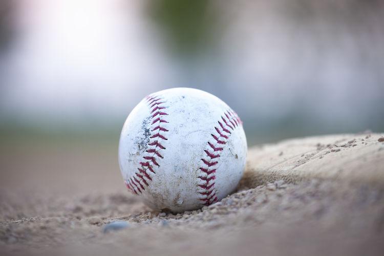 Close-up of baseball on ground
