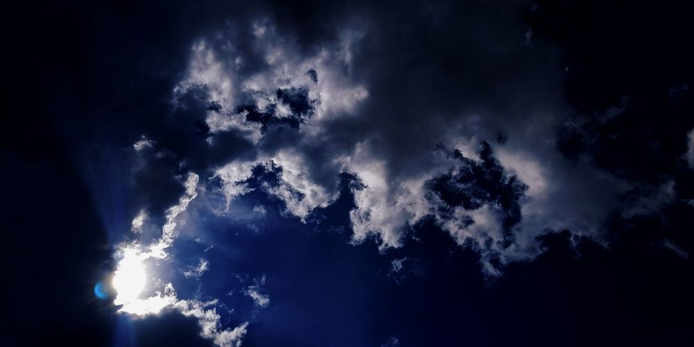 Low angle view of clouds in sky at night