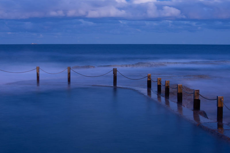 Beach Beauty In Nature Blue Cloud - Sky Day Horizon Horizon Over Water Idyllic Land Nature No People Outdoors Post Scenics - Nature Sea Sky Tranquil Scene Tranquility Water Wooden Post
