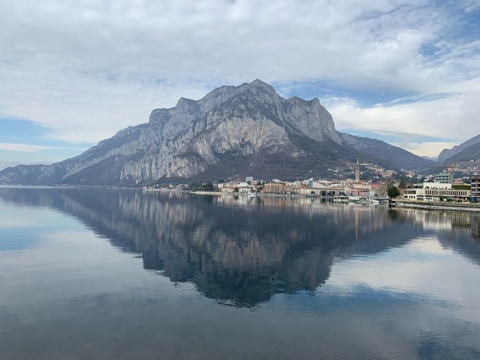 Como Lake Como EyeEm Selects Water Sky Reflection Mountain Cloud - Sky Waterfront Beauty In Nature Scenics - Nature Architecture Tranquility Building Exterior Nature Mountain Range Symmetry Lake No People Outdoors Tranquil Scene Built Structure