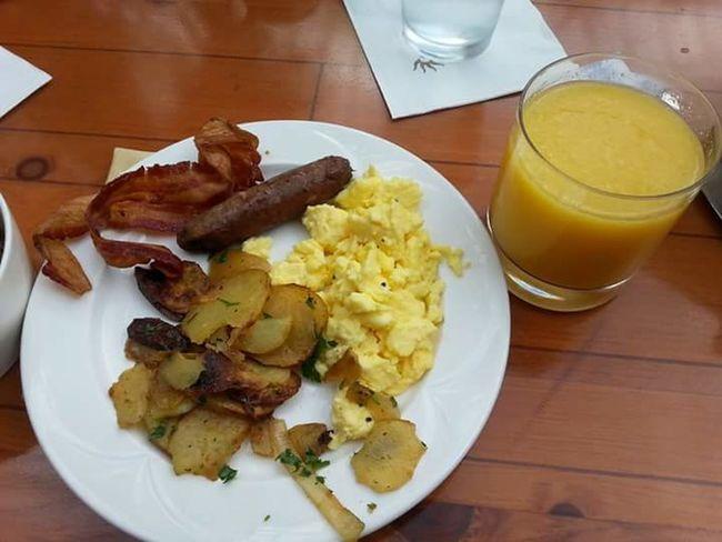 Breakfast Hotel Breakfast Eggs... Sausage Potatoes Orange Juice  Delicious Oprylandresort Bacon!