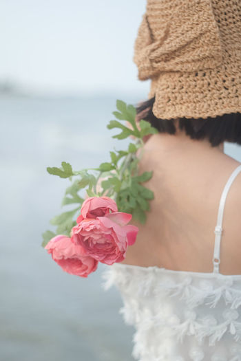 Low section of woman with pink roses