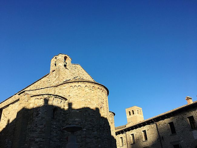 Architecture History Low Angle View Built Structure Clear Sky Building Exterior Copy Space The Past Blue Ancient Day Fort No People Travel Destinations Outdoors Sunlight Churches Bell Tower Medieval San Leo Italy Emilia Romagna