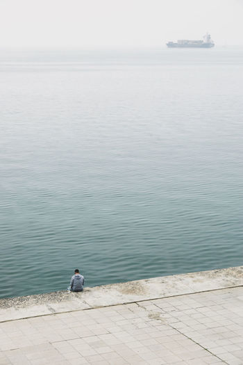 Day Fishing Pole Fog Foggy High Angle View Horizon Over Water Lonley Lonlyness Man Men One Person Outdoors Real People Sea Seaside Ship Sky Tranquil Scene Tranquility Water