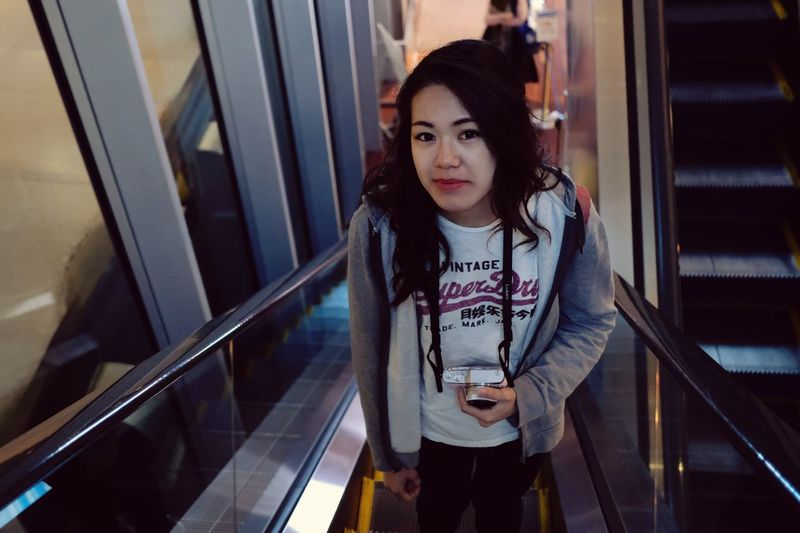 Portrait of teenage girl standing on staircase