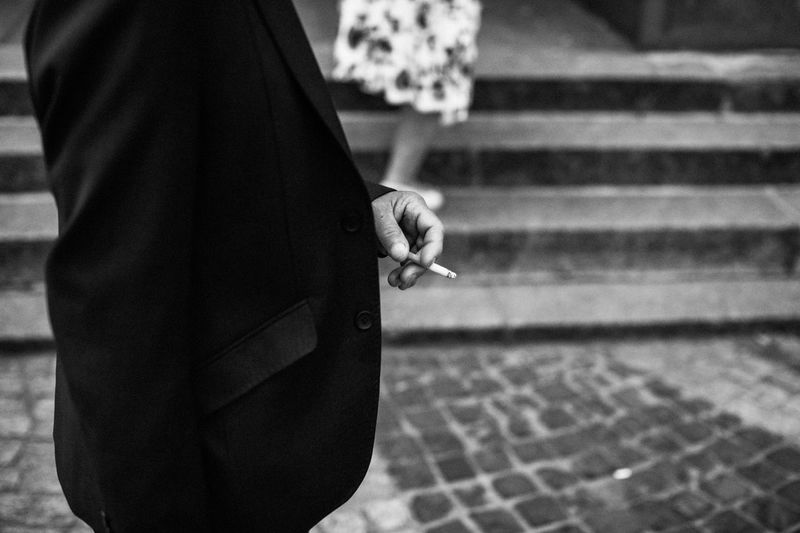Capture The Moment EyeEm Best Shots - Black + White Love Letter To Poland The Week on EyeEm Bad Habit Black And White Photography Canonphotography Cigarette  Day Focus On Foreground Hand Holding Lifestyles Light And Shadow Men Midsection Monochrome One Person Real People RISK Sign Smoking - Activity Smoking Issues Social Issues Streetphotography Warning Sign The Street Photographer - 2018 EyeEm Awards