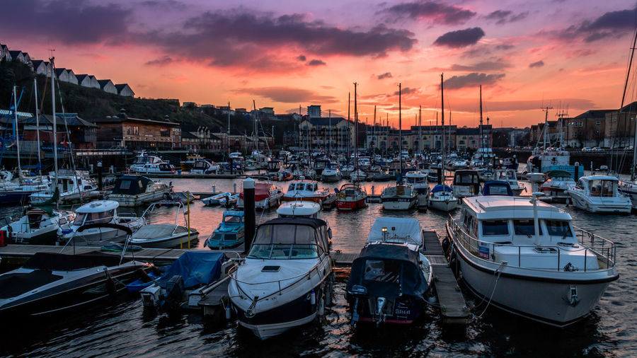 Moored boats under a blazing sky Boats Boats And Moorings Boats And Water Boats Boats Boats Harbor High Contrast Mast Moored Nautical Vessel Orange Color Outdoors Red Color Sky Sky On Fire Sunset Water