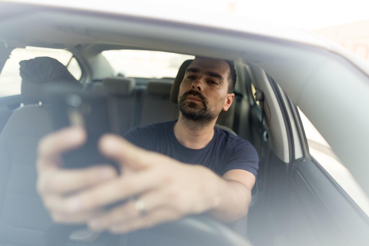 Man Using Mobile Phone In Car