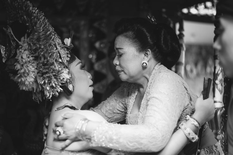 the wedding tradition of Balinese people who leave their parents to marry loved ones EyeEm Best Shots EyeEmNewHere EyeEm Selects EyeEm EyeEm Gallery Eyeemphotography Mother Mothers Day Familly Balinese Culture Tradition Mother & Daughter Mother's Day Motherslove Traditional Culture Young Women Togetherness Bonding Women Females Bride Couple - Relationship Warm Clothing