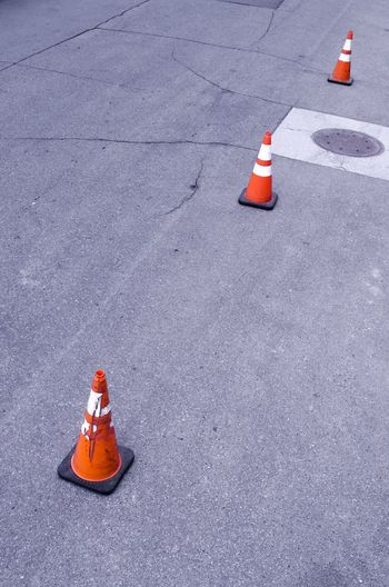 High angle view of traffic cones on road in city